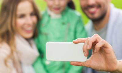 close up of family taking selfie by smartphone