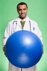 Doctor holding an exercise ball