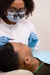 Man having teeth examined