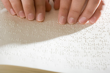 One woman reading braille
