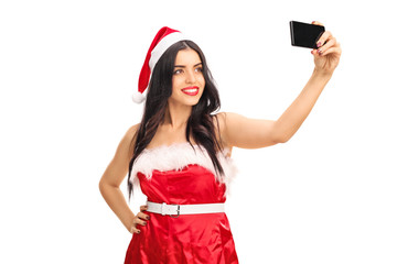 Young woman in Santa outfit taking a selfie