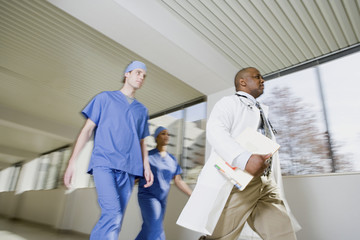 Doctor and surgeons walking