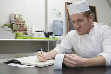 Chef doing accounts