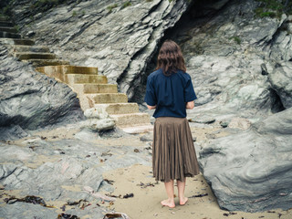 Woman looking at stairs on beach