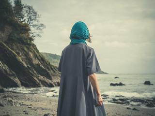 Woman wih headscarf on beach