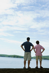 Father and son looking at lake
