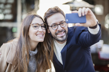 Dating young couple happy in love taking selfie self-portrait photo