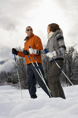Mature couple skiing