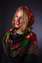 Beautiful woman in a red traditional Russian shawl