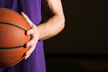 Man holding basketball