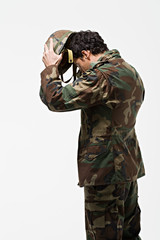 Soldier putting on helmet