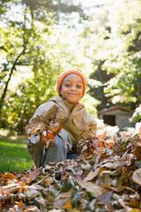Boy holding leaves