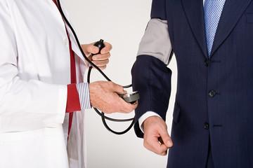 Businessman having a medical check up