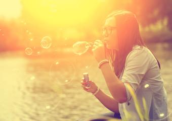 Soap bubble blower woman in sunset
