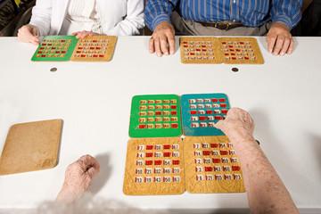 Three seniors playing bingo