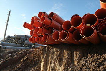 red plastic water pipes construction site