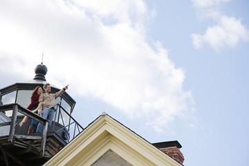 One couple on a balcony