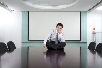 Businessman in Conference Room