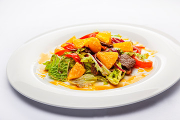 Warm salad from veal, orange and green