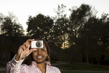 Female student taking a photograph outdoors