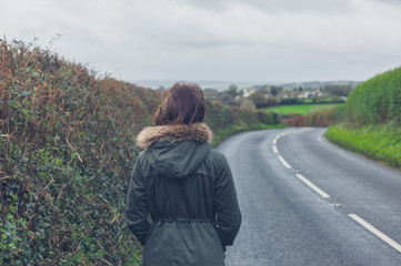 Woman walking on country road