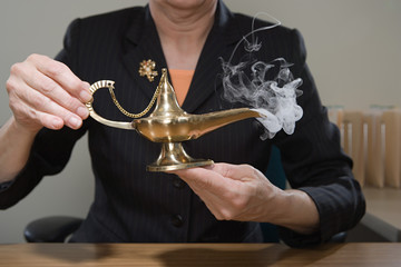 Woman holding genie lamp