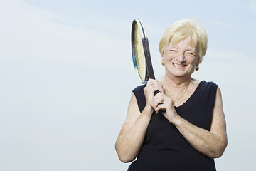 Senior woman with tennis racket