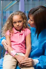 Nurse comforting anxious girl