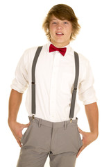 young man in suspenders stand smile