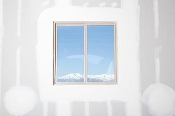 A view of mountains through a window