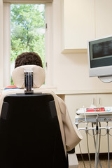 Rear view of person in dentist chair