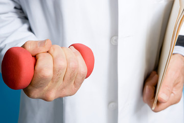 Doctor holding a dumbbell