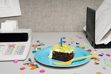 Birthday cake on an office desk