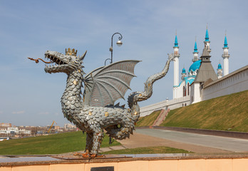 Kazan. Sculpture fabulous animal Zilant dragon at the entrance to the subway on the background of the Kazan Kremlin
