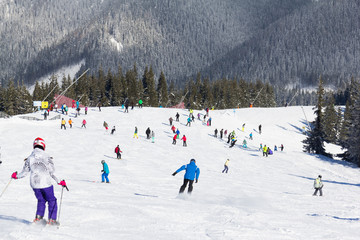 Skiers and snowboarders enjoying good snow