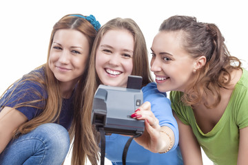 Three Young Happy caucasian Females With Photocamera Taking Selfie Photographs