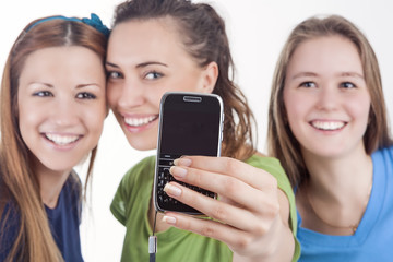Lifestyle Concept and Ideas. Three Beautiful Caucasian Ladies Taking Selfie Photo Using Smartphone