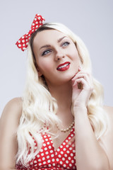 Young Caucasian Blond Female Posing in Pinup Style Against White