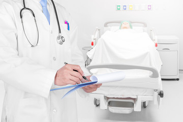 Doctor writing a medical prescription with medical background