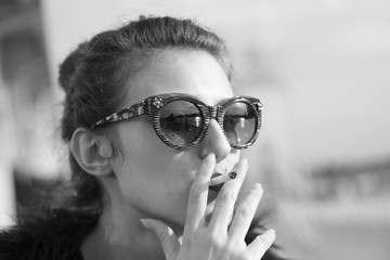 Beautiful girl portrait in retro style smoking the cigarette black and white photography