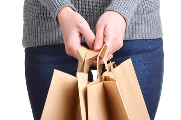 shopping bags for purchases in the hands of women isolated on white background