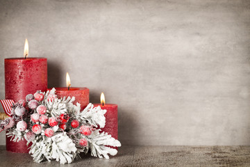 Red burning candle on a gray background. Interior items.