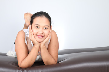 Charming woman Smile face close up and she lying on the sofa, mo