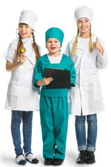 Cute little children dressed like doctor looking at camera with  cheerful smile isolated on white background. medicine concept