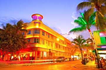 Miami Beach, Florida Moving traffic hotels and restaurants at sunset on Ocean Drive, world famous destination for it's nightlife, beautiful summer  weather and pristine beaches