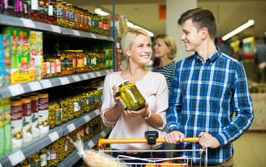 Clients buying tinned food
