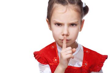 Little girl put her finger to her lips