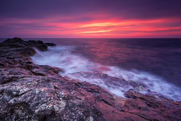 Printed kitchen splashbacks Eggplant Rocky sunrise. Magnificent sunrise view in the blue hour at the Black sea coast, Bulgaria.