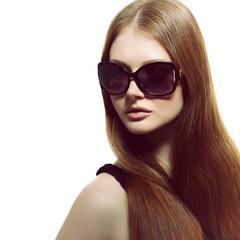 Girl in sunglasses. Beautiful woman in sunglasses posing in stud