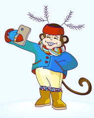 Monkey with deer antlers on his head taking selfie photo on smart phone. Carnival costume as deer antler made of fir branches.